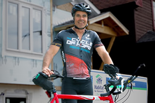 Dr. Dean Schrader completes his ride from Kansas City to Winnipeg in support of Habitat for Humanity